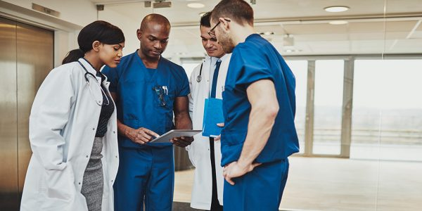 Doctors streamlining operational workflows with a document automation software